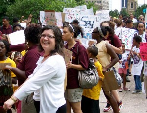 MTSO alum Laura Young (white sweater) leads scholars from Broad Street UMC to the Ohio Statehouse during the National Day of Social Action July 13