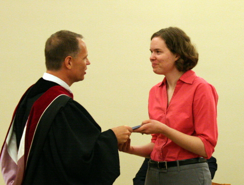 President Jay Rundell presents graduating senior Meredith McDougle with the C. Everett and Mary Milburn Tilson Social Justice Grant